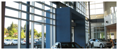 Commercial building with large wall of windows in Rocklin, CA cleaned by Paul Blacks.